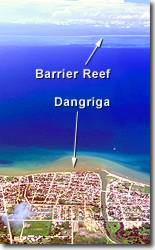 Dangriga> from 10000 feet with barrier reef on horizon